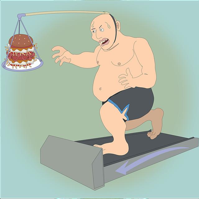 Homme sur un tapis de marche avec un gâteau devant